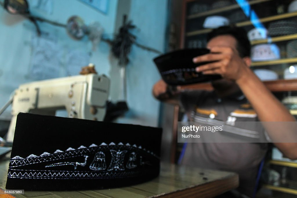 A cap was sewing artisans cap motif of Aceh in the Home Industries Village Beurandang, Syamtalira Bayu Sub-district , North Aceh, Aceh province, Indonesia on June 26, 2016. Orders in the cap -making holy month of Ramadan 1437 H has increased to 80% with total production reaching thousands of scores that are marketed to a number of provinces in Indonesia.