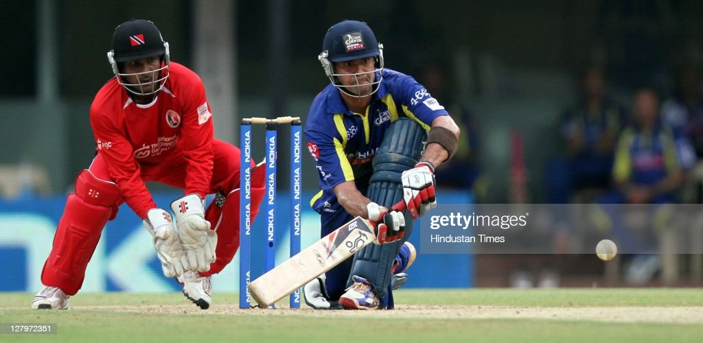 Cape Cobras batsman Owais Shah gets in position to play a shot as Trinidad & Tobago wicketkeeper Dinesh Ramdin looks on during the Champions League Twenty20 Group A match between Cape Cobras and Trinidad & Tobago at M. A. Chidambaram Stadium on October 4, 2011 in Chennai, India.