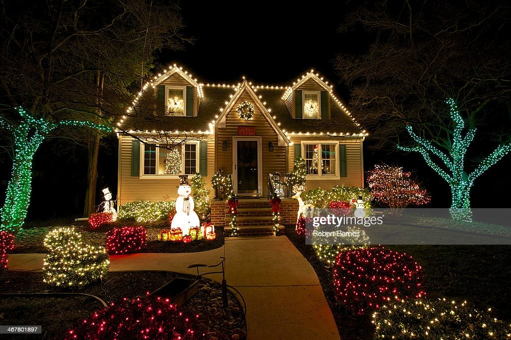 White And Colored Christmas Lights Part - 15: A Cape Cod Style House In Medford, NJ Is Outlined With White Christmas  Lights With