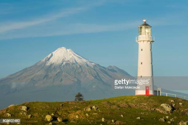 Cape Egmont lighthouse with Mount Taranaki, New Zealand