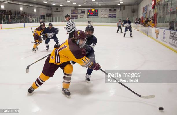 Cape Elizabeth junior Ethan Gillespie and Yarmouth sophomore Sam Marjerison both go after the puck during the Class B South quarterfinal Yarmouth...