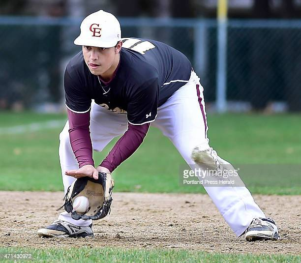 Cape Elizabeth shortstop #10 Matt Dennison keeps his eyes on the ball as he fields a hard hit grounder and throws to first to put the runner out as...