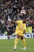 Orlando Pirates Destin Makita challenges 24 July 2007 Tottenham Hotspur striker Darren Bent during the Vodacom Challenge match at Newlands stadium in...
