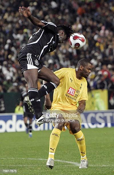 Orlando Pirates Destin Makita challenges 24 July 2007 Tottenham Hotspur striker Darren Bent during the Vodacom Challenge match at Newlands stadium in...