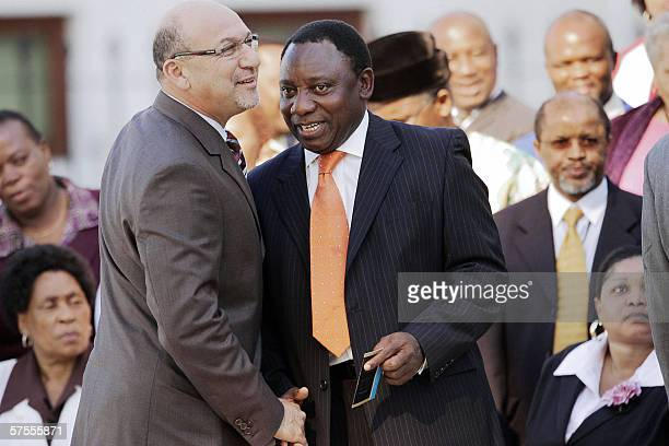 South African Minister of Finance Trevor Manuel greets Cyril Ramaphosa former CoChairman of the Constitutional Assembly the body which drew up South...
