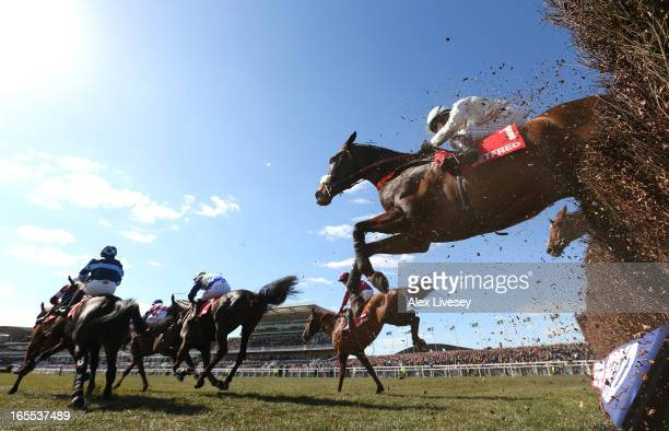 Cape Tribulation ridden by Denis O'Regan clear the last fence during The Betfred Bowl Steeple Chase at Aintree Racecourse on April 4 2013 in...