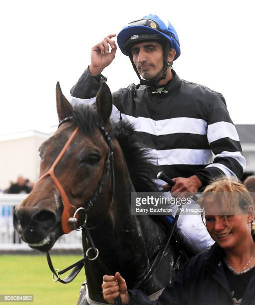 Cape Vale and jockey Ahmed Ajtebi after winning the Toppers Wales Handicapat Ffos Las Racecourse Trimsaran