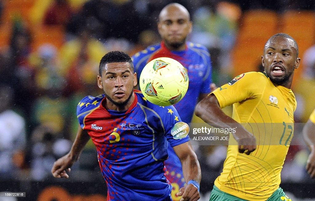 Cape Verde midfielder Babanco (L) and South Africa striker Bernard Parker watch the ball during a group A football match at the 2013 African Cup of Nations in Soweto on January 19, 2013 at Soccer City.