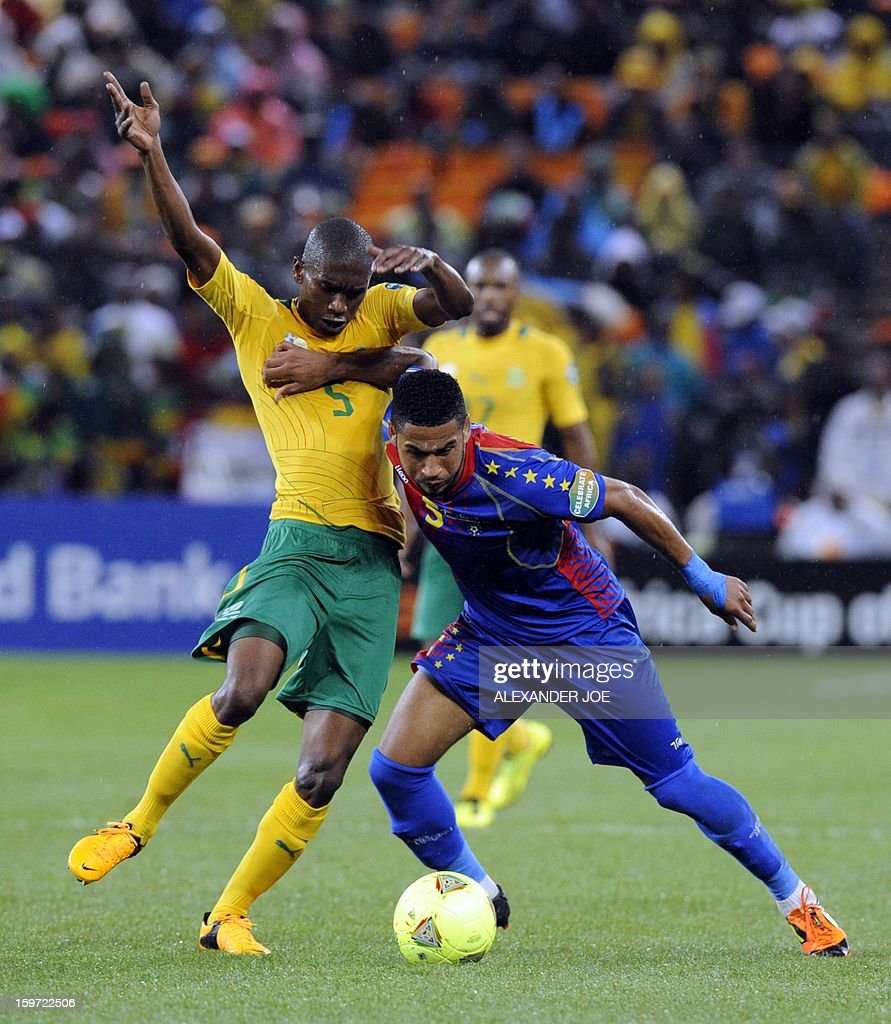 Cape Verde midfielder Babanco (R) fights off South Africa's defender Anele Ngcongca during a group A football match at the 2013 African Cup of Nations in Soweto on January 19, 2013 at Soccer City.