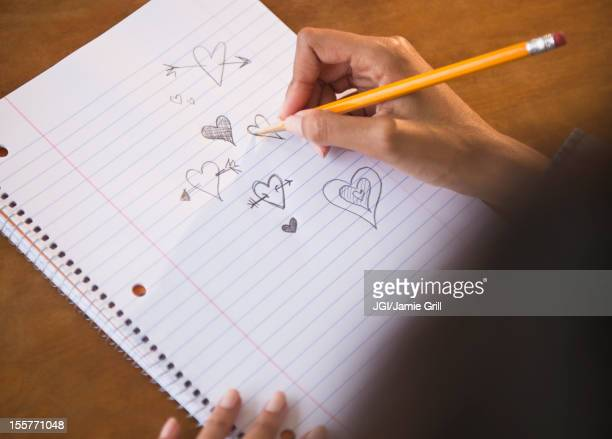 Cape Verdean woman doodling hearts