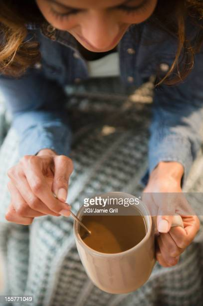Cape Verdean woman drinking coffee