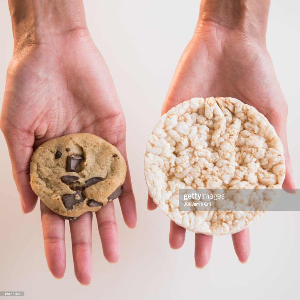 Cape Verdean woman holding cookie and rice cake