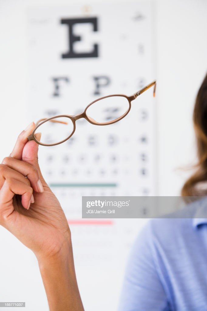 Cape Verdean woman holding eyeglasses