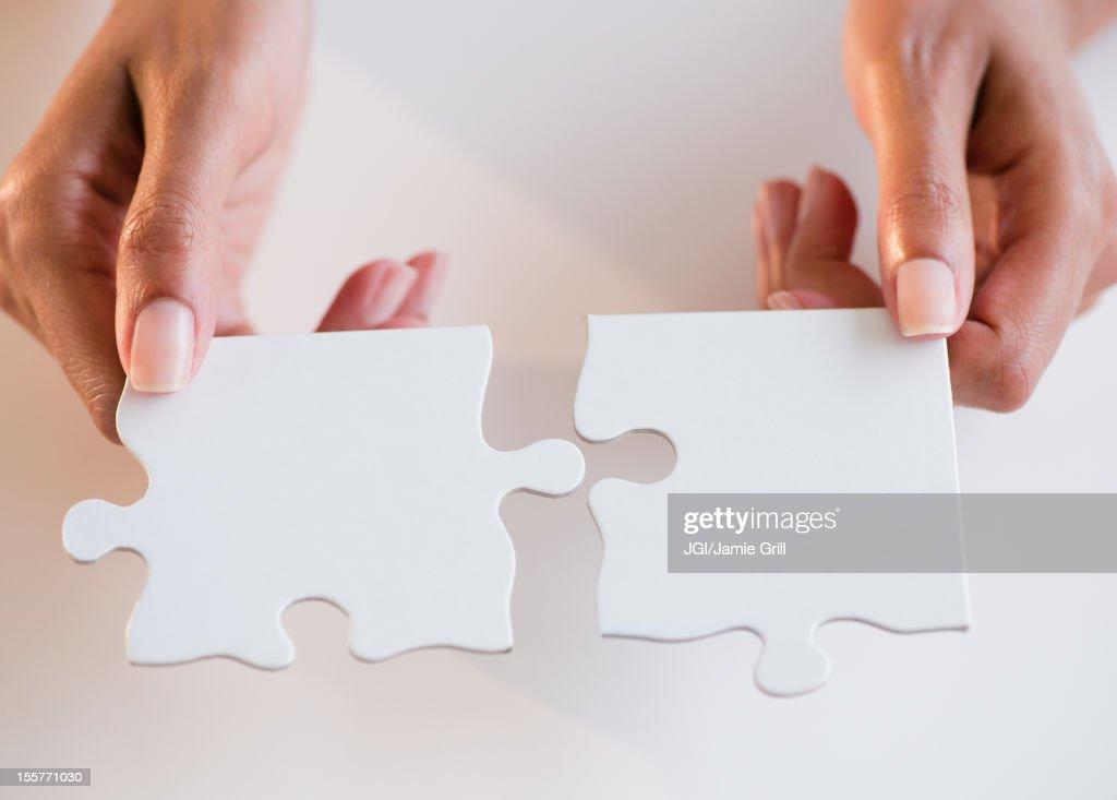 Cape Verdean woman holding puzzle pieces