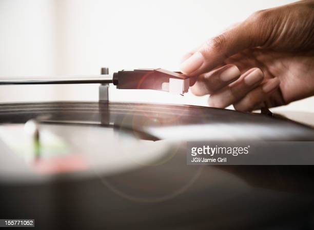 Cape Verdean woman listening to vinyl record