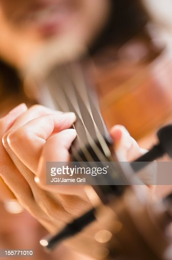 Cape Verdean woman playing the violin