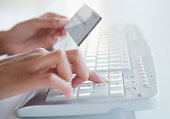 Cape Verdean woman shopping online with credit card