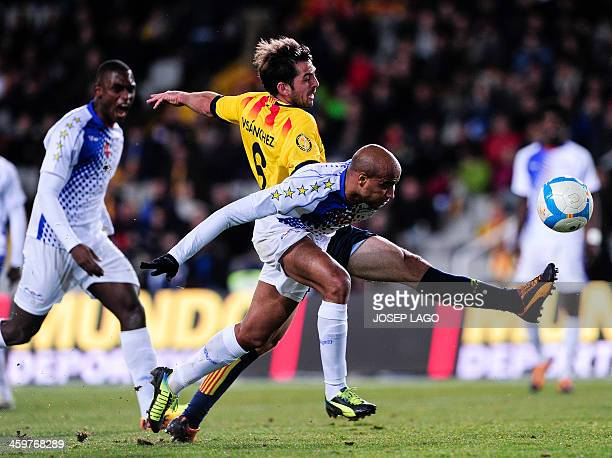 Cape Verde's defender Nivaldo Santos 'Tax' vies with Catalonia's midfielder Victor Sanchez during the friendly football match Catalonia national team...