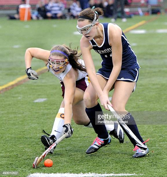 Cape's Jane Coffrin fights with Yarmouth's Hannah Peters for control of the ball as Cape Elizabeth field hockey hosts Yarmouth at Hannaford Field in...