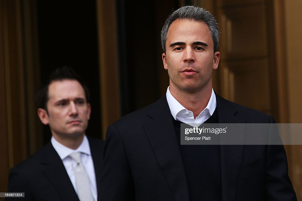 Capital Advisors portfolio manager Michael Steinberg (R) walks out of a New York courthouse after being charged by U.S. prosecutors with engaging in insider trading on March 29, 2013 in New York City. Federal Bureau of Investigation (FBI) agents arrested Steinberg at his home in New York City at around 6 a.m. on charges of using inside information to make trades in shares of chipmaker Nvidia Corp and Dell Inc.