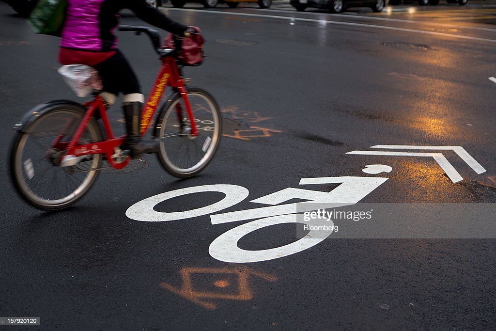 A Capital Bikeshare bicyclist rides on a bike lane in Washington, D.C., U.S., on Friday, Dec. 7, 2012. Since Sept. 2010, Capital Bikeshare has dispersed more than 1700 bikes for rent across the city and has totaled over 3.5 million rides since Sept. 2011. Alta Bicycle Share, the company that was awarded the contract to run the program, has installed 191 solar-powered docking stations throughout the District and Arlington, Virginia. Photographer: Andrew Harrer/Bloomberg via Getty Images