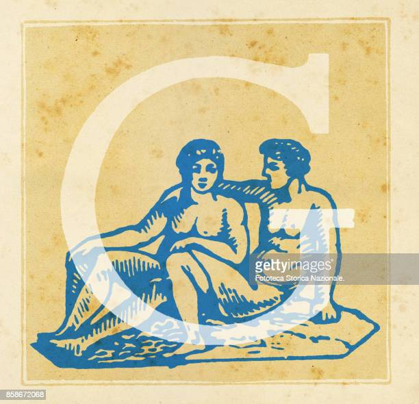 Capital letter G with zodiacal sign of the Gemini Digital illustration realized by assembling 19th century printing elements by Elena Piccini Italy...
