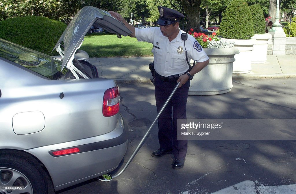 U.S. Capital Policeman checking cars as they enter the grounds of the Capital.