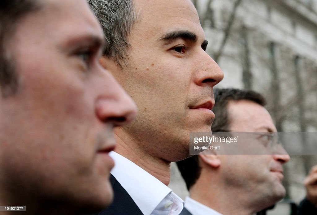 Capital portfolio manager Michael Steinberg (C) walks with his lawyers as he leaves federal court after being arraigned on insider trading charges on March 29, 2013 in New York City. Federal Bureau of Investigation (FBI) agents arrested Steinberg at his home in New York City at around 6 a.m. on charges of using inside information to make trades in shares of chipmaker Nvidia Corp and Dell Inc.