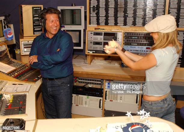 Capital Radio DJ Dr Fox and Atomic Kitten's Jenny Frost in a cake fight after blowing out candles on a birthday cake at the Capital Radio studio in...