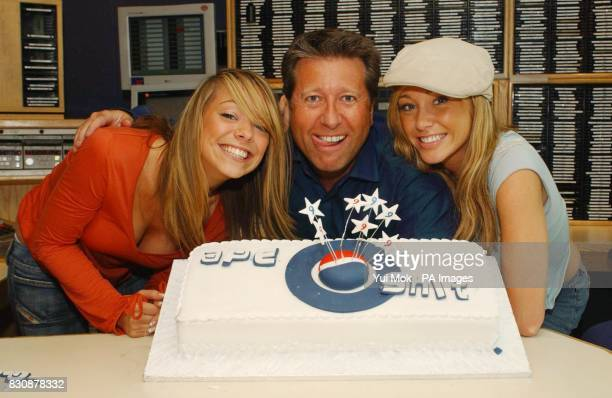 Capital Radio DJ Dr Fox and Atomic Kitten's Liz McClarnon and Jenny Frost blow out candles on a birthday cake at the Capital Radio studio in London's...