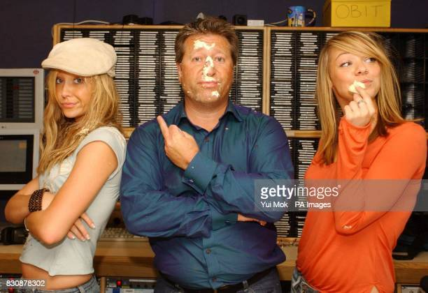Capital Radio DJ Dr Fox and Atomic Kitten's Liz McClarnon Jenny Frost after blowing out candles on a birthday cake at the Capital Radio studio in...