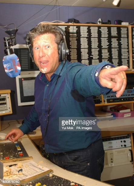 Capital Radio DJ Dr Fox points to Atomic Kitten's Jenny Frost after their cake fight at the Capital Radio studio in London's Leicester Square * Fox...