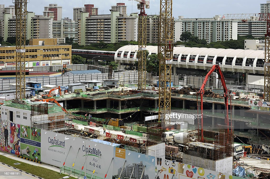 CapitaLand Ltd.'s Bedok Residences mixed development project sits under construction in Singapore, on Monday, Feb. 18, 2013. CapitaLand, Southeast Asia's biggest developer, is scheduled to release fourth quarter earnings on Feb. 21. Photographer: Munshi Ahmed/Bloomberg via Getty Images