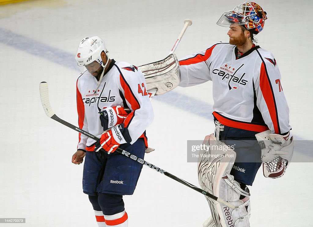 Capitals' Joel Ward (42), left, gets a pat on the back from goalie Braden Holtby (70), right as they exit the ice after the New York Rangers defeat the Washington Capitals 2 - 1 in game 7 to win the NHL Eastern Semifinals at Madison Square Garden in New York NY May 10, 2012