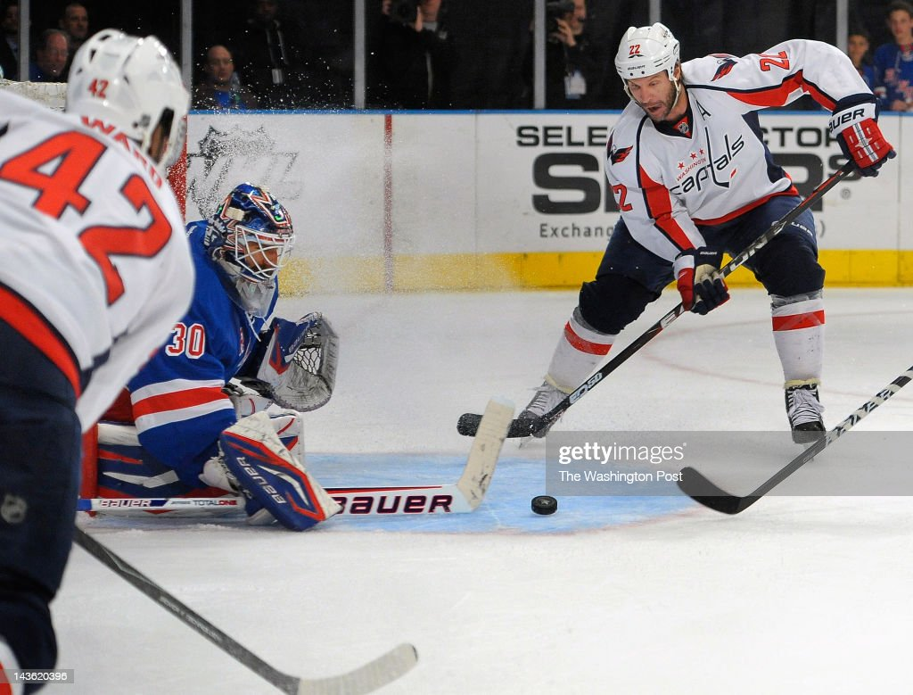 Capitals right wing Joel Ward (42), left, passes the puck in front of Rangers goalie Henrik Lundqvist (30), center, to Capitals right wing Mike Knuble (22), right, who, puts it in for the first goal of the game in the 1st period during the Washington Capitals defeat of the New York Rangers 3- 2 in game 2 of the eastern semi finals of the NHL playoffs at Madison Square Garden in New York NY April 30, 2012