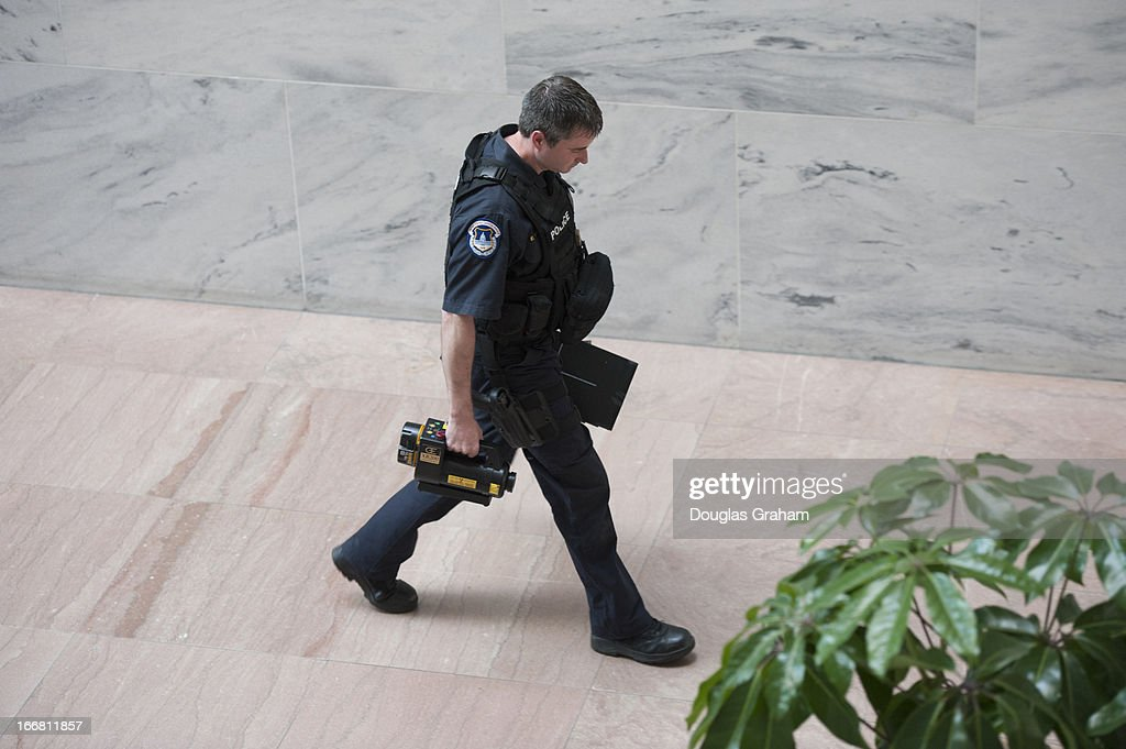 A U.S. Capitol Hill Police bomb detection unit member walks into the Hart Senate Office Building. The Hart building was cleared as bomb squads checked a backpack left unattended in the hallway.