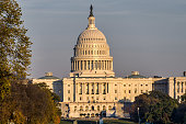 US Capitol, house of Congress seen with golden sunset light