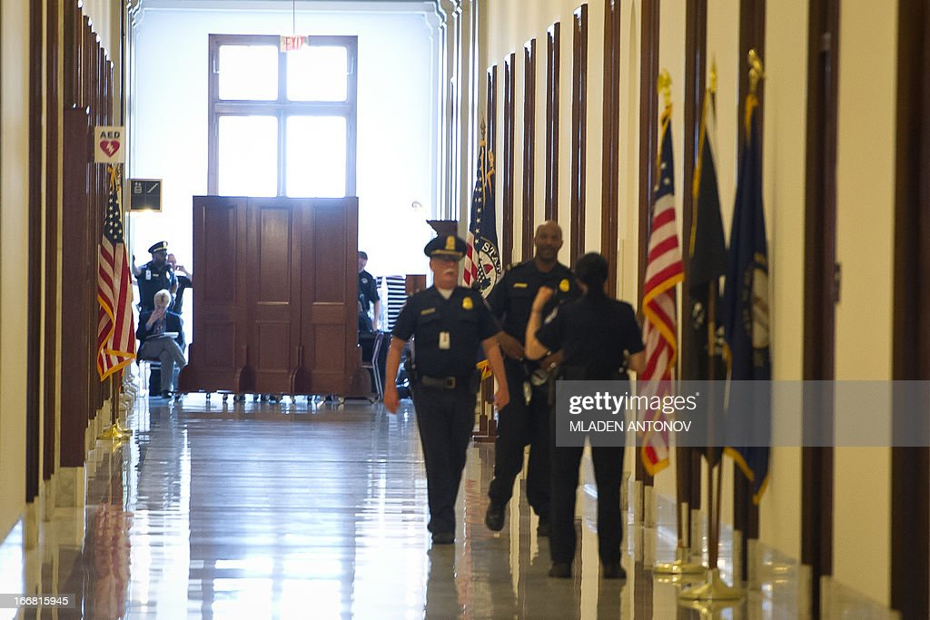 US Capitol police closes a corridor of the Russell Senate office building after receiving reports of a suspicious package, in Washington DC, April 17, 2013. At the US Capitol, sections of two Senate office buildings were briefly cordoned off amid reports of a suspicious package. Capitol Police later said results of tests conducted at the Hart and Russell Senate office buildings were negative and the closed-off areas were reopened. AFP PHOTO / Mladen ANTONOV