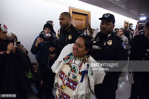 Capitol Police detain a demonstrator outside of Senate Environment and Public Works Committee confirmation hearing on Capitol Hill January 18 2017 in...