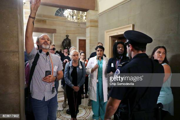 S Capitol Police keep a group of protesters that broke away from a tour away from senators and the Senate Chamber at the US Capitol July 27 2017 in...
