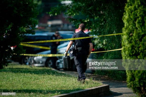 Capitol Police officer arrives after a shooting during a practice of the Republican congressional baseball at Eugene Simpson Statium Park June 14...