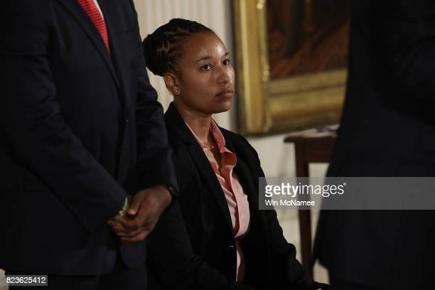 S Capitol Police officer Crystal Griner listens as US President Donald Trump delivers remarks during an event in the East Room of the White House...