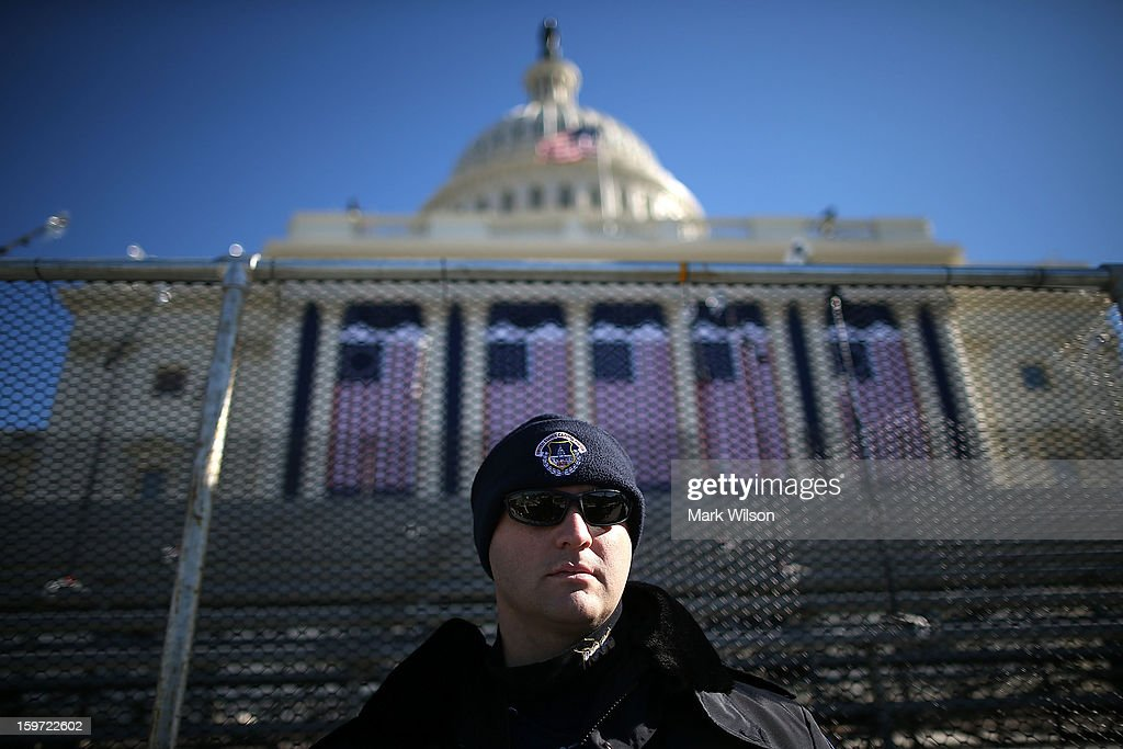 U.S. Capitol Police officer Jeffery Ferguson stands guard over the inauguration platform at the U.S. Capitol Building on January 19, 2013 in Washington, DC. The U.S. capital is preparing for the second inauguration of U.S. President Barack Obama, which will take place on January 21.