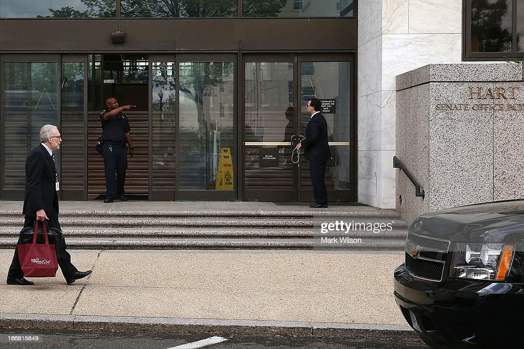 S. Capitol Police Officer prevents a man from entering the Hart Senate Office Building after the first floor was evacuated April 17, 2013 in Washington, DC. U.S. Capitol Police were investigating three suspicious packages in the Hart and Russell Senate Office buildings.