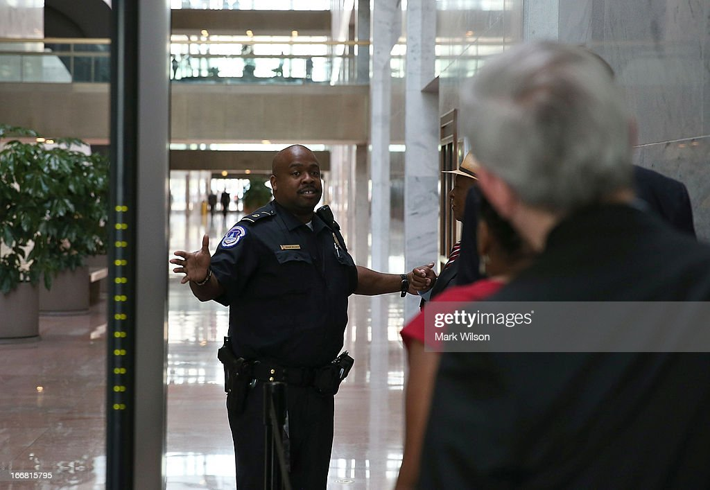 A U.S. Capitol Police Officer prevents people from entering the Hart Senate Office Building after the first floor was evacuated April 17, 2013 in Washington, DC. U.S. Capitol Police were investigating three suspicious packages in the Hart and Russell Senate Office buildings.