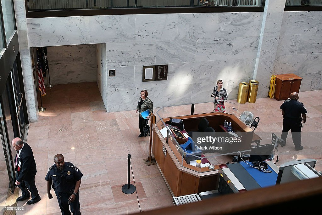 U.S. Capitol Police Officers ask people to leave the first floor of the Hart Senate Office Building April 17, 2013 in Washington, DC. U.S. Capitol Police were investigating three suspicious packages in the Hart and Russell Senate Office buildings.
