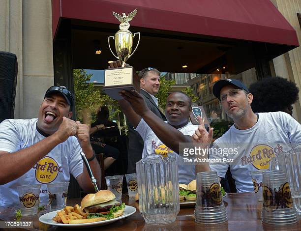 Capitol police officers exult in victory as local law enforcement officials partake in a hamburger eating contest at Hard Rock Cafe on June 2013 in...