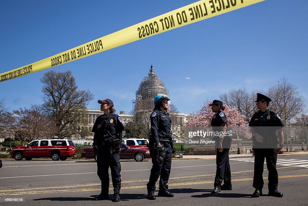 S Capitol Police officers stand outside the west front of the US Capitol April 11 2015 in Washington DC According to the US Capitol Police the...