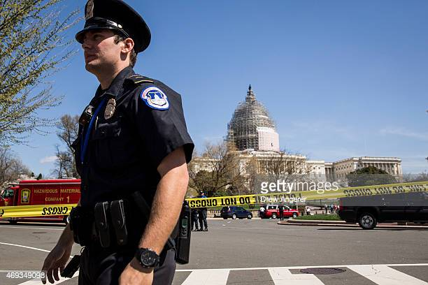 S Capitol Police officers stand outside the west front of the US Capitol on Capitol Hill April 11 2015 in Washington DC According to the US Capitol...