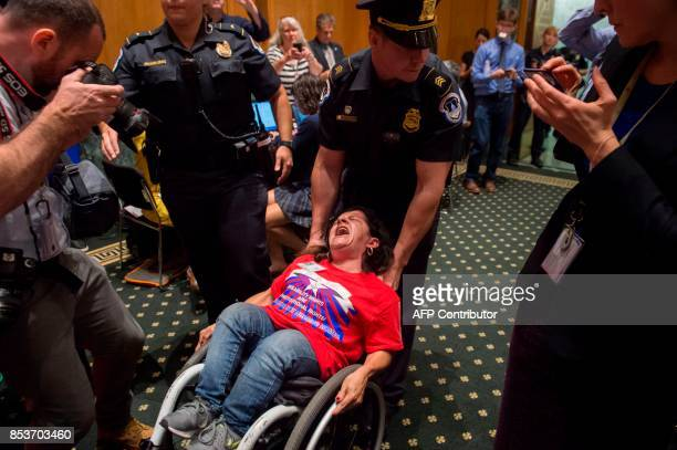 Capitol Police remove protestors from the US Senate Committee on Finance hearing on the GrahamCassidyHellerJohnson Proposal on reforming health care...